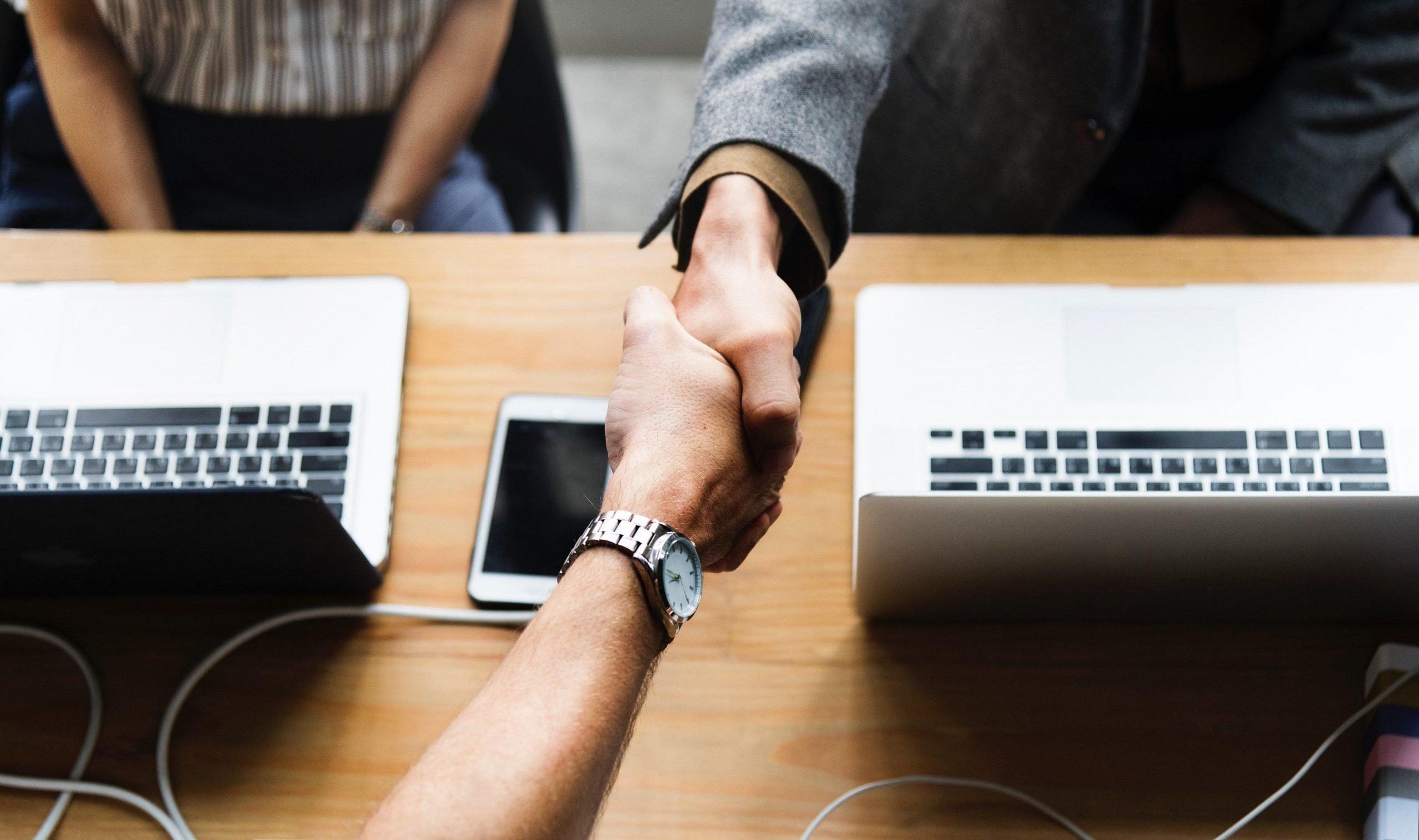 payroll solutions handshake