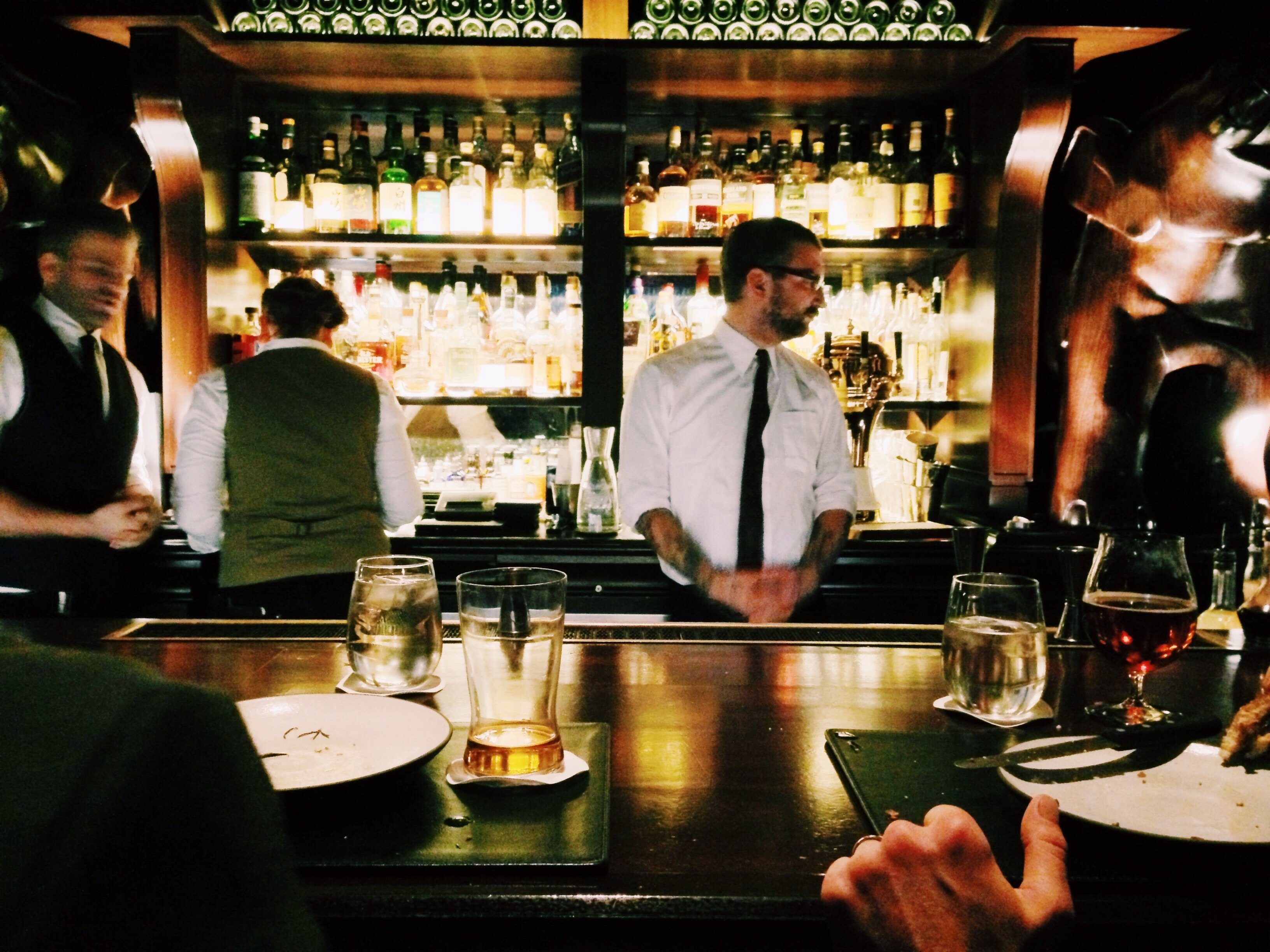 labor cost. Bartender standing behind the bar.
