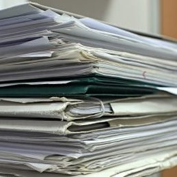 A pile of folders holding invoices.