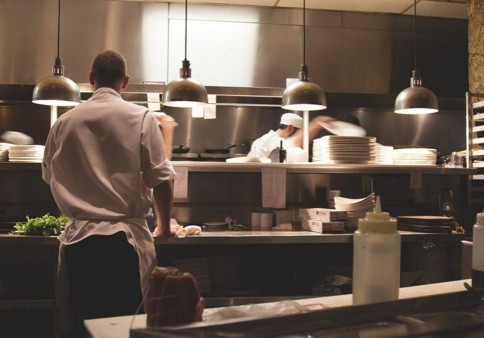 Cooks working in the kitchen under new exemption rules.